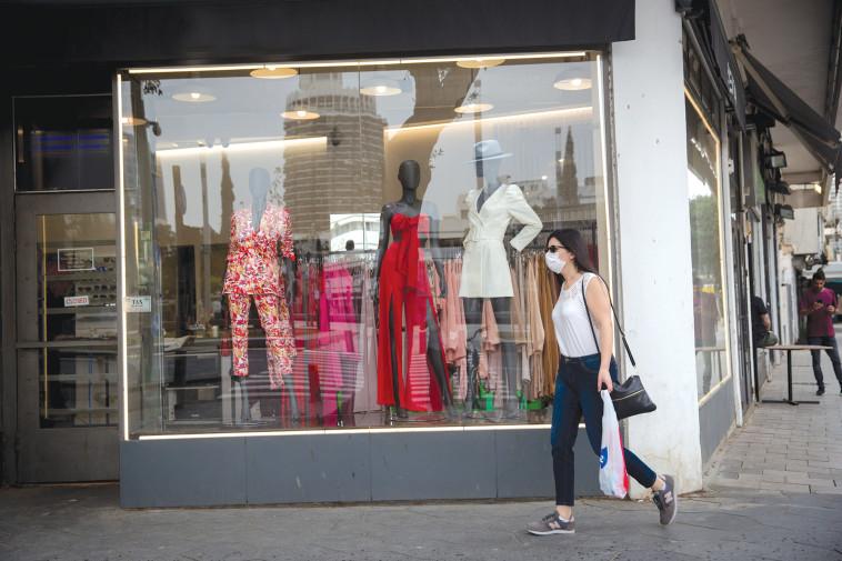 קורונה - חנות סגורה בתל אביב  (צילום: מרים אלסטר, פלאש 90)