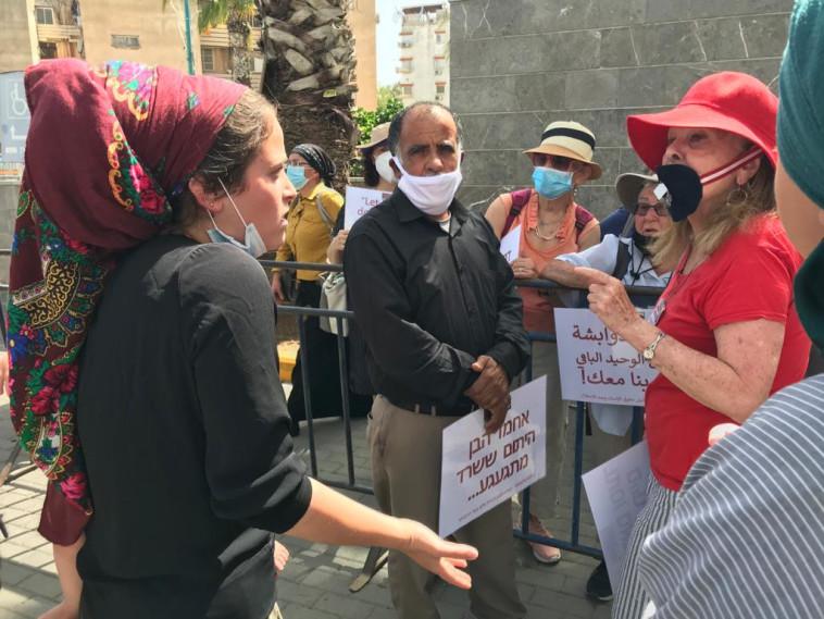 עימות מחוץ לבית המשפט בדיון של עמירם בן אוליאל (צילום: אבשלום ששוני)