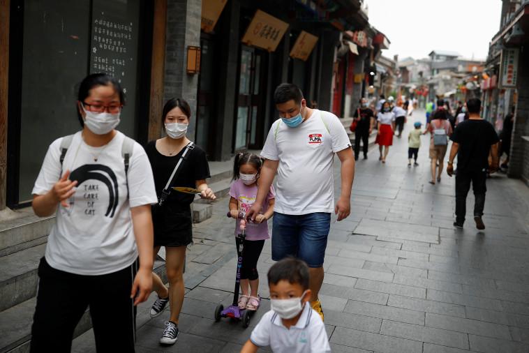 קורונה בסין  (צילום: REUTERS/Thomas Peter)