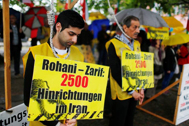 אזרחים איראניים נגד ההוצאות להורג במדינה (צילום: REUTERS/Hannibal Hanschke)