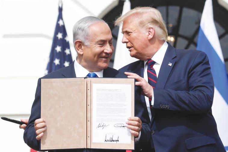 טראמפ ונתניהו בחתימת ההסכם (צילום: רויטרס)