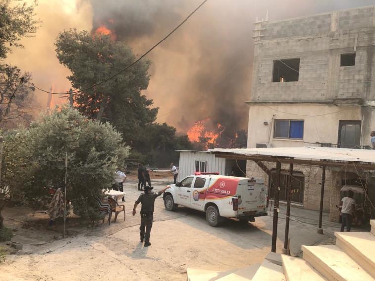 כוחות ההצלה במהלך כיבוי השריפות (צילום: תיעוד מבצעי כבאות והצלה)