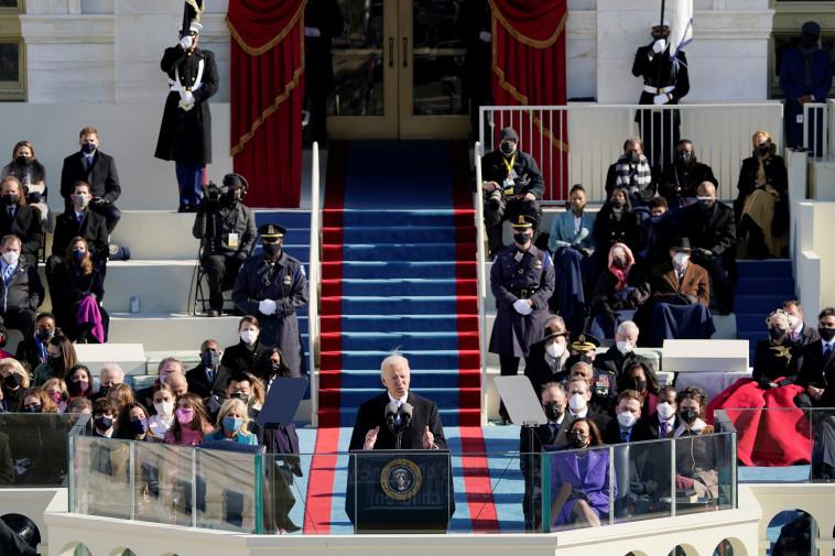 ג'ו ביידן בנאום בטקס ההשבעה (צילום: Patrick Semansky/Pool via REUTERS)
