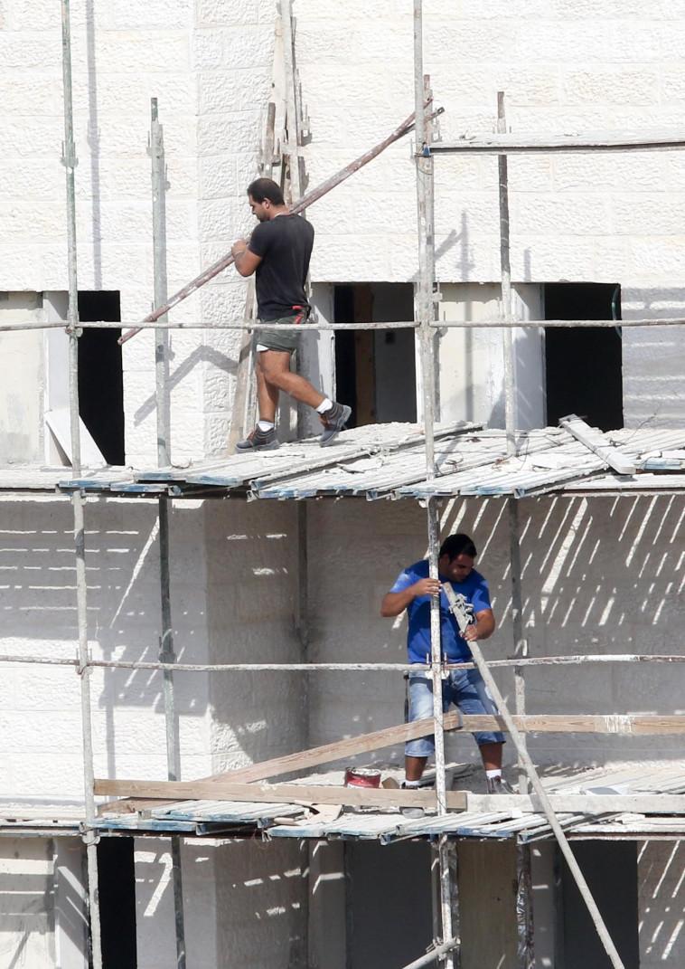 פועלי בניין במודיעין (צילום: דני מרון)