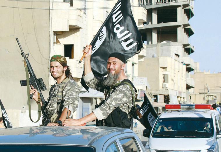 פעילי דאעש בסוריה (צילום: רויטרס)