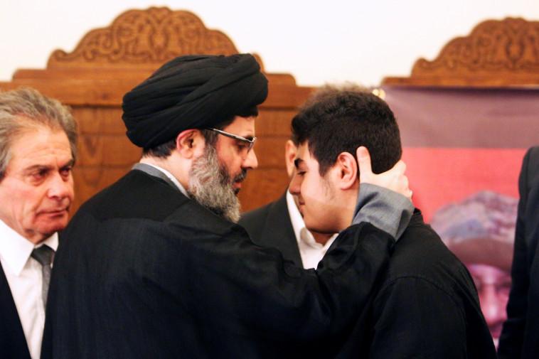 הישאם ספי א-דין והבן של מוספא בדר א-דין (צילום: רויטרס)