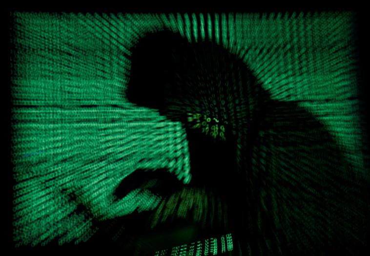 האקר, מתקפת סייבר (צילום: REUTERS/Dado Ruvic)