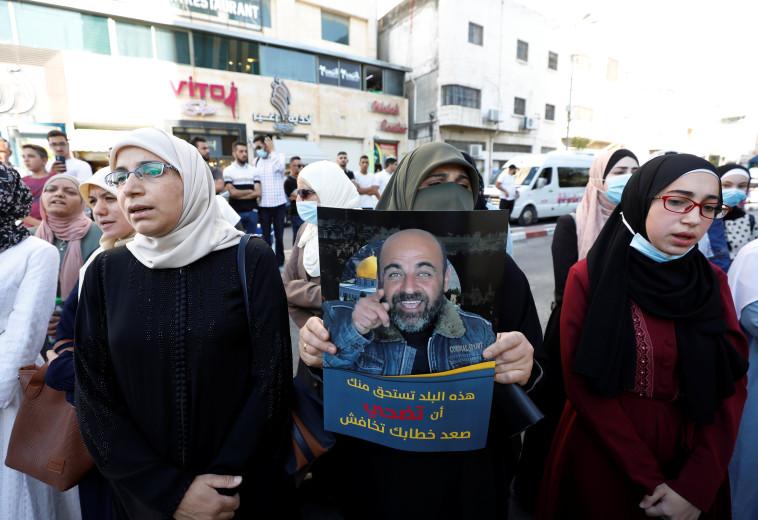 הפגנה בחברון (צילום: REUTERS/Mussa Qawasma)