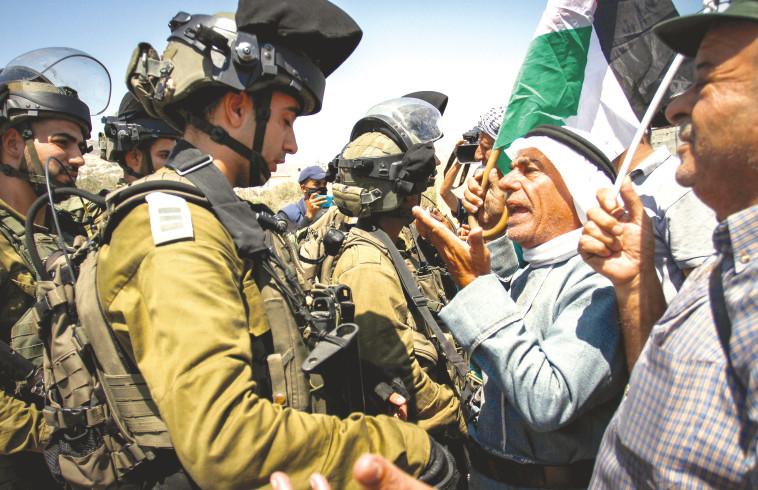 עימותים בין פלסטינים לכוח צהל באזור שכם (צילום: נאסר אישתאיה, פלאש 90)