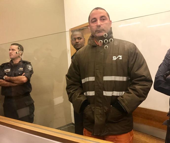 איש העסקים ג'קי בן זקן במדי אסיר בבית המשפט