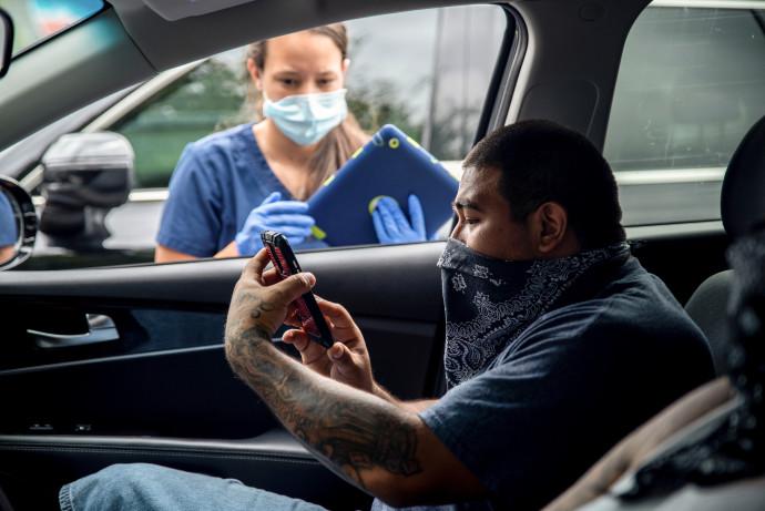 בדיקות קורונה באוסטין, טקסס. צילום: Sergio Flores/רויטרס